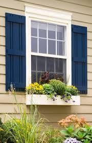 Trendy front door colors with tan house black shutters planters 17 Ideas Window Shutters Exterior, Outdoor Shutters, House Shutters, Black Shutters, Diy Shutters, Homes With Shutters, Outside Window Shutters, Diy Exterior Shutters Ideas, Windows With Shutters
