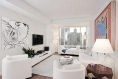 Beautiful Art Deco style modern white living room decor, white living room decor with white sofa colorful Art