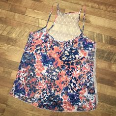 Floral print tank with lace back Floral print tank with lace back. Great to wear in the summer! Tops Tank Tops