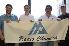 (l-r) Talented composers David and Yoni Gottlieb help display the Radio Chavura banner with hosts Dean and Maxwell Rotbart.  (Photo by Avital Rotbart)
