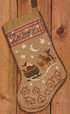 Bent Creek Christmas Eve Stocking - Cross Stitch Pattern. Up up and away! Santa and his reindeer are on their Christmas Eve ride. Model stitched over 2 threads: