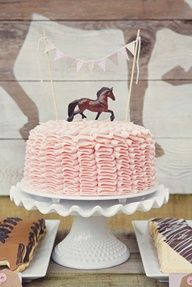 pink brown cream vintage themed pony ride birthday party ruffle cake with bunting and horse topper