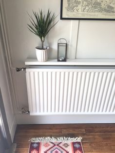 Find out how I made this simple DIY hall console shelf to detract from an ugly radiator using something most of us have bought or have in our homes already! simple home diy A Hallway Wish List - Dekko Bird Radiator Shelf, Radiator Cover, Hallway Shelf, Grey Hallway, Ledge Shelf, Home Radiators, Console Shelf, Flur Design, Hallway Designs