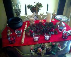Decorating your Yule altar - choose your candles in the color of the Yuletide season such as: red, green, white, gold, silver.  Pick an incense that you would smell in the winter time such as: bayberry, pine, spruce, spice, cedar, cinnamon. Decorate the circle with holly, mistletoe, ivy, pine, pine cones, a Yule Log, and place ash twigs in the cauldron (to burn for prosperity).  Feel inspired and add thing to your Yule altar and circle to celebrate the season.