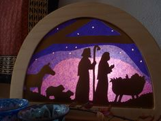 Christmas scene in blue which appears to be purple.
