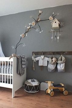 i love this fot a boys room, the grey walls and the rustic wood with clean white crib.