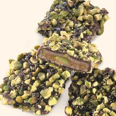 """A Special Nutty Toffee Treat """"It is a winner! Really delicious., Vero Beach, FL Chocolate Pistachio Toffee is smooth toffee enrobed in rich dark chocolate, then coated with roasted pistachios. Candy Recipes, Sweet Recipes, Holiday Recipes, Dessert Recipes, Delicious Desserts, Just Desserts, Yummy Food, Pistachio Recipes, Biscuits"""