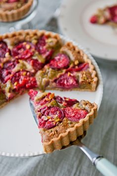 Plum Pistachio Frangipane Tart, for a twist on the classic almond paste crust, flavor of pistachio works wonderfully.