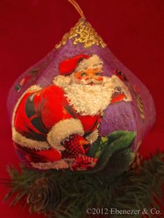 Handcrafted Heirloom Decoupage Ornament featuring a Vintage Image of Santa Claus on Christmas Eve. $95.00, via Etsy.