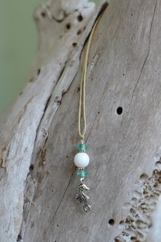 Seahorse Pendant Necklace with Ocean Glass Accents. $6.00, via Etsy.