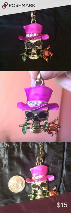 """Top Hat Skull Necklace Painted pink enamel hat with three crystals. Bronze/orange rose (flower) with crystals and green stem sits in mouth of skull. Lobster clasp. Approximately 15"""" long (chain & pendant). Bronze chain. Please ask if you have questions. Unique. Day of the dead. Funky. Goth. Halloween. Punk. Costume. Fashion. Edgy. Brim. Jewelry Necklaces"""