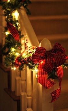 love lights, garland, and ribbon on the banisters for Christmas. Love reds during Christmas great idea for my banister with kayias paper chains she loves to make
