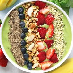 Tropical Green Smoothie Bowl with granola, fruit, chia and hemp heart topping