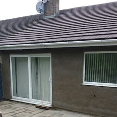 Rendering a bungalow in Torfaen to a Tyrolean finish.