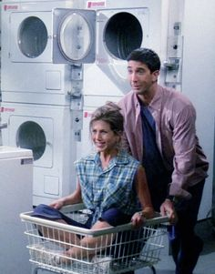 Ross and Rachel are at the laundromat taking back the laundry cart that another woman took from them.