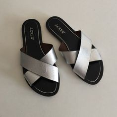 Jcrew silver and black flat sandals sliders 6 Great condition. Minor scratches on the upper leather straps. They are a size 6 but run small. Bundle to save 25%! J. Crew Shoes Sandals