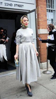 Ulyana Sergeenko adds fifties glam with a silk headscarf.Streetstyle