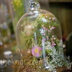 Glass domes, not quite with these flowers but I like the idea. Gives an artistic, precious and sculptural feel to the flowers