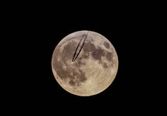 Plane flying past supermoon by Shawn Flanagan on 500px