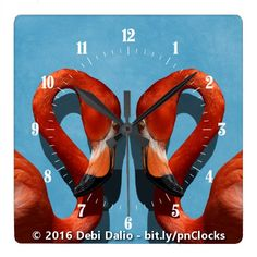 This cool wall clock features a close-up of two facing orange American flamingos against a light blue textured background. http://www.zazzle.com/two_flamingos_with_curved_necks_square_wall_clock-256663398922658335?rf=238083504576446517&tc=20161110_pint_NSoZ #animals #birds #photography #Zazzle #StudioDalio