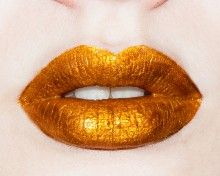 Golden Ticket lip gloss from Lime Crime. It's like liquid gold for your lips.