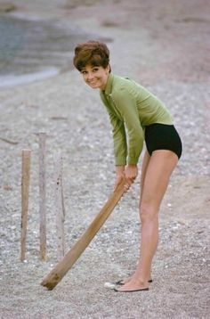 Audrey Hepburn playing beach cricket in St Tropez, 1960s. Photo by Terry O'Neill.