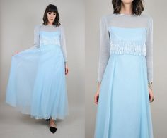 Vintage 60s powder blue Jack Bryan gown. Tiered beaded fringe detail at waist. Sheer illusion chest and sleeves. Sheer full skirt - lined. Zipper and hooks down back. Please see measurements for fit. We only have ONE of each item. ✂ - - - MEASUREMENTS: (all were taken while laying flat)  B R A N D : Jack Bryan / Charlottes West of Akron B U S T : 17 W A I S T : 13.5 L E N G T H : 55.5 S H O U L D E R : 14.5 H I P S : full S L E E V E : 20.5 F A B R I C : silk? / acetate / rayon  In excellent…