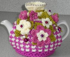 magenta and raspberry floral...hand knitted by peerietreisures