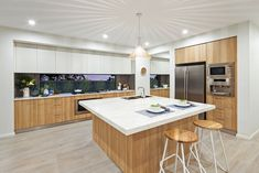The Nova Display by Mojo Homes Sydney. A square Island bench works as a great ca Square Island Kitchen, Square Kitchen Layout, Kitchen Island Bench, Kitchen Layouts With Island, Kitchen Benches, Kitchen Stools, Kitchen Flooring, Kitchen Dining, Kitchen White
