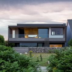 Welsh seaside home by Hyde + Hyde sits on the edge of a cliff