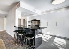 Modern kitchen with black laminate countertop peninsula white gloss cabinets Laminate Countertops, Kitchen Countertops, Modern Kitchen Design, Kitchen Designs, Cabinets, Furniture, Black, Home Decor, Armoires