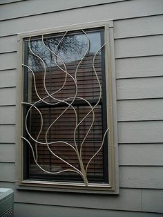 Decorative Window Bars - the next step.  Just be sure they have a quick release, or you'll have to remove them when you sell. Fire code and all. :)