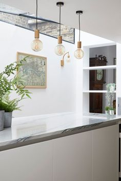 Photo Credit: Anna Stathaki #sidereturnglazing #quartziteworktop #marbleisland #walllight #wallscounce #mapart #bornandbredstudio #kitchenideas #extension #sidereturnextension #islandlighting #pendantlighting #grandfatherclock #oldandnew #theavesqueenspark #queenspark #theavenues #queensparkconservationarea
