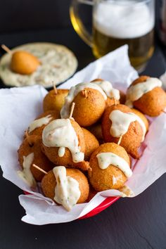 Mini Brat Corn Dogs with Caramelized Onion Cheddar Sauce | halfbakedharvest.com