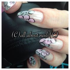 Pretty pink and grey flowers.  Cute almond shape nails.  Done by Kari at All About Nails & Training.  www.allaboutnails.org