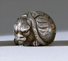 """SILVER OJIME In the form of a tiger with inlaid eyes. Signed. Length .6"""""""