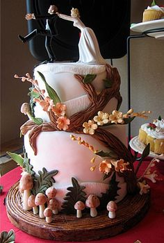 Woodland Wedding Cake--cute detail--topper is silly--but love the little ferns and mushrooms!