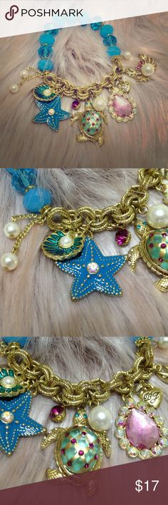 Betsey Johnson Mermaid Ocean Charm Bracelet Soooo cute! Comes with dangly pearl charms, a clam, starfish, turtle, pink gemstone, heart, and crab charm attached. Stretchy elastic on the beaded side. Makes a great gift. Like new. Betsey Johnson Jewelry Bracelets