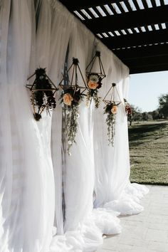Wedding ceremony backdrop inspiration: white tulle and geometric copper floral hangings | Image by Gloria Goode Photography