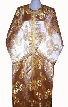 Gold Casawiya Caftan  - $49.99  A caftan that's simplistic yet stunning. Slip into graceful, pure comfort in this kaftan made in Morocco with embrodered hamming along the sleeves, the neck, the center of the kaftan, and also around the bottom edge.  Hand wash only.   One size fits up to a 42 inches bust around and is 56 inches long.   Sleeves are 20 inches long.  https://treasuresofmorocco.com/shop/?slug=product_info.php&cPath=23_30&products_id=410