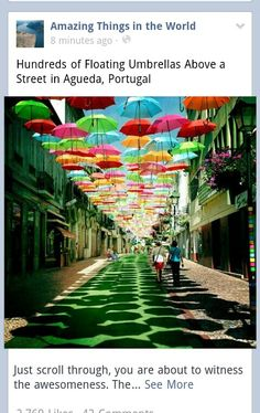 You ever see Hundreds of Floating Umbrellas Above A Street? If you travel to Agueda in Portugal during July you will see it with colorful umbrellas floating above some streets. Umbrella Street, Umbrella Art, The Places Youll Go, Places To See, Beautiful World, Beautiful Places, Colorful Umbrellas, Sidewalk Art, Public Art