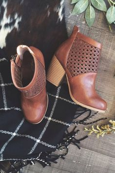 Autumn // Shoes- heeled brown leather ankle boots with holes around the top