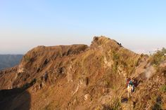 Trekking to the top of Mount Batur, Bali as the sun rises over the volcano and the lakes, forests and villages below. Check out our website for more info on Mount Batur sunrise trekking tours.