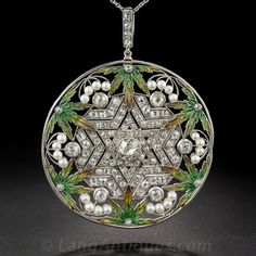 Bélle Epoque Plique-a-Jour Enamel and Diamond Pendant. You don't have to be Jewish to appreciate the symbolism of this fascinating Edwardian/Art Nouveau beauty. A central six-pointed star (of David), centered with a three-quarter carat old mine-cut diamond, and all aglitter with tiny old mine-cut diamonds radiates outward pointing the way to a half-dozen multi-color plique-a-jour enamel cannabis leaves (!). Twenty-four seed pearls and ninety-eight mine-cut diamonds decorate...platinum