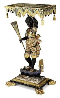 A VENETIAN POLYCHROME-PAINTED AND PARCEL-GILT TABLE   LATE 19TH/EARLY 20TH CENTURY   The top draped with simulated fabric supported by a blackamoor standing on a gondola, the base with paw feet, with inscription 'VENECIA'  36 in. (91.5 cm.) high; 19¾ in. (50 cm.) wide; 13½ in. (34.5 cm.) deep  5250gbp wbp