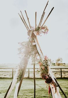 Will you say 'I do' in the great outdoors? This rustic wooden tipi covered in flowers would make a beautiful backdrop for your outdoor wedding vows!