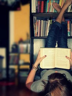 One of my favorite ways to be. Reading...not necessarily upside down