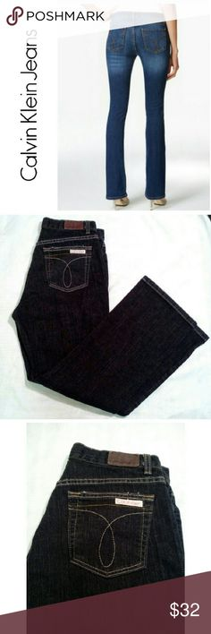 CALVIN KLEIN STRETCH BOOT CUT JEANS CALVIN KLEIN DARK COLOR BLUE BOOT CUT JEANS *.  99% COTTON BUT HAS SOME STRETCH *.  BOOT CUT *.  W 32 X L 30 *.  ADDED FRINGE ON CUFFS *. PRACTICALLY NEW - NO TAG Calvin Klein Jeans Boot Cut