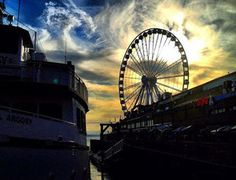 Visit the Seattle Great Wheel at Pier 57! For adults, a ride costs USD 13 and for children 12 and under, it's USD 8.50.