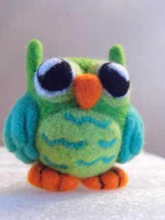Cute hand crafted owl made from 100% merino wool, Available in six adorable colors.Coming soon a kit to make your own felted owl.